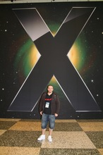 Magnus infront of the huge X logo.jpg