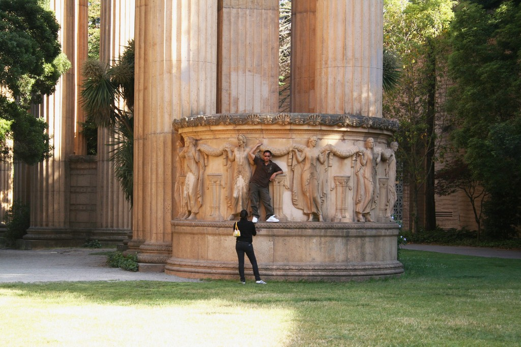 Young couple takes photos in Palace of Fine Arts