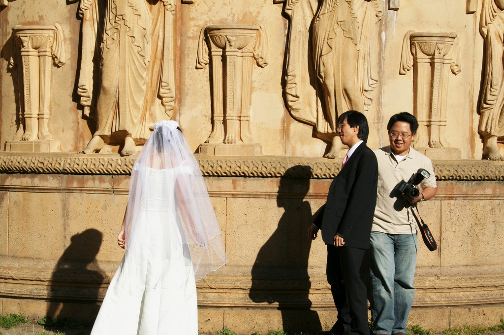 Asian bridal couple gets photographed at the Palace of Fine Arts