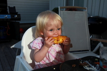 Meya enjoys grilled corn
