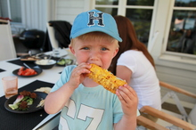 Melvin enjoys grilled corn