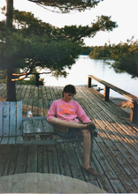 Jakob reading a mag on the deck.jpg
