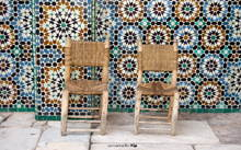 Two chairs on tiles background