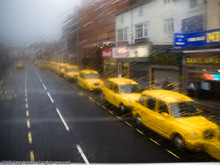 ZigZag-Taxis through a rainy bus window