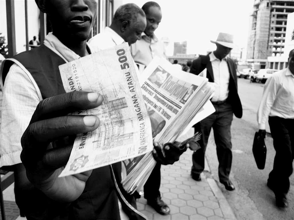 At the newsagent. 500 Rwf for the daily rag