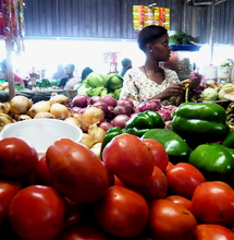 Tomato seller at Kimironko market in Kigali