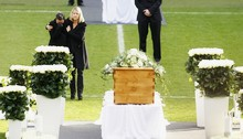 Teresa Enke and an unidentified woman stand at the coffin of German goalkeeper Robert Enke in the stadium at Hanover