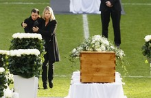 Teresa Enke and an unidentified woman stand at the coffin of German goalkeeper Robert Enke inside the stadium of first division Bundesliga soccer club Hannover 96 in the northern German city of HanoverHanover