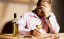 83385944 Unhappy man with a glass of wine