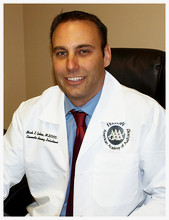 Audiologist Mark Gustina