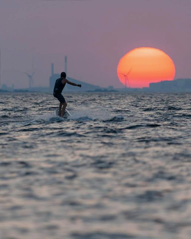 Surfing to the sunset