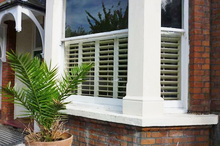 Bay Cafe Style Plantation Shutters.jpg